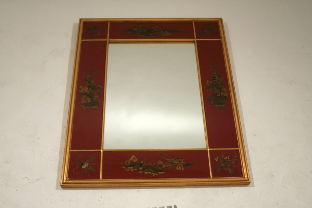 A Red Lacquered And Gilt Decorated Panel Framed Mirror For
