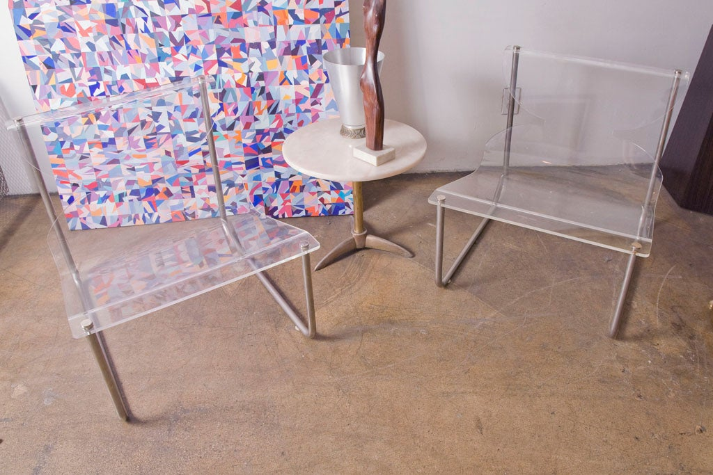 Nice and elegant pair of lucite and chrome sling chairs by Charles Hollis Jones.