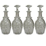 A set of four Cut Crystal Decanters