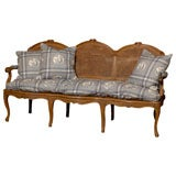 French 1860s Louis XV Style Fruitwood and Cane Canapé with Linen Upholstery