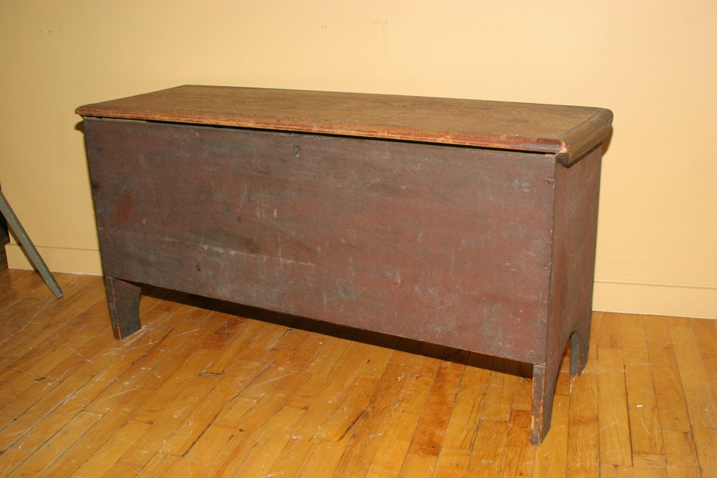 Fine American six-board blanket chest in beautiful, dry green paint over original red.  Molded top.  High half-moon bootjack ends.  Original snipe hinges.  New England origin, circa 1790.