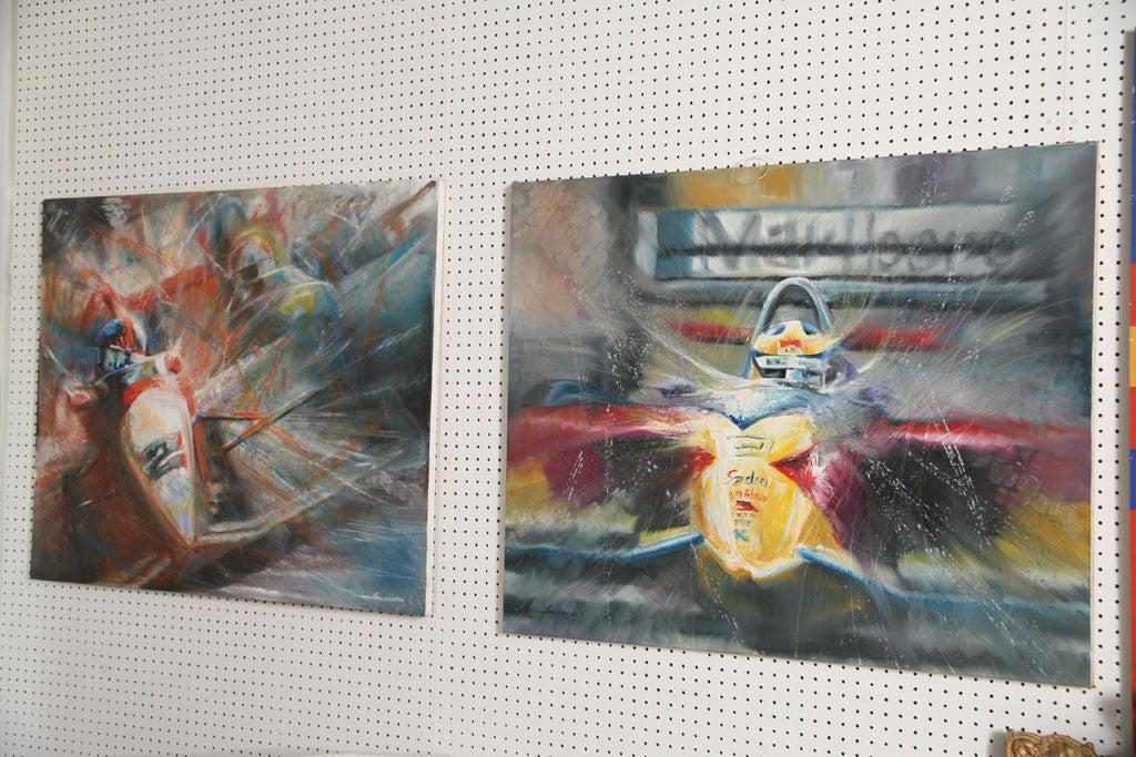 A pair of Brazilian painter Solaris famous Formula 1 paintings.