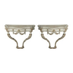 Pair of Italian Neoclassic Cream Painted, Parcel-Gilt Consoles