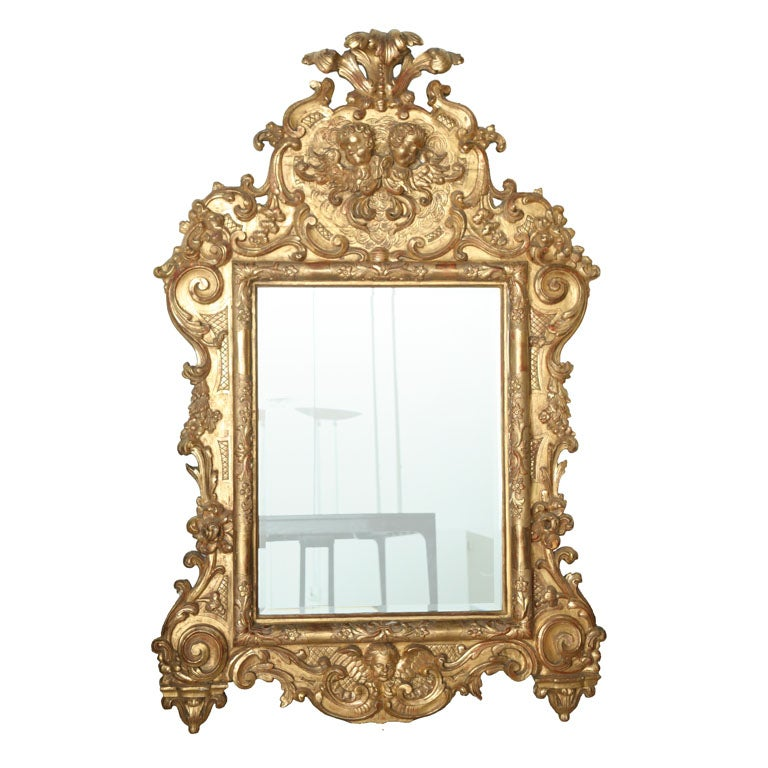 Fine and Monumental Italian Baroque Giltwood Mirror For Sale