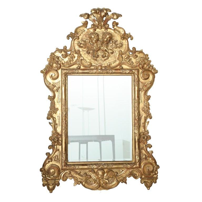 Fine and monumental italian baroque giltwood mirror for for Italian baroque mirror