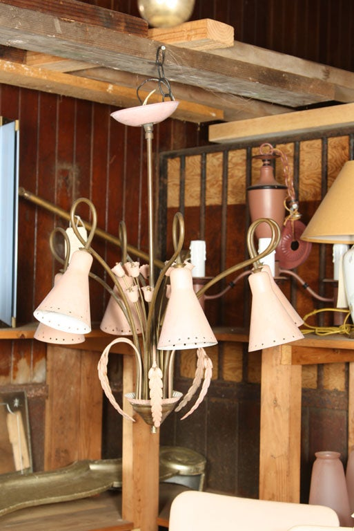 A fanciful pink painted metal and brass floral style chandelier with 6 cone shaped shades, 1950s-1960s.