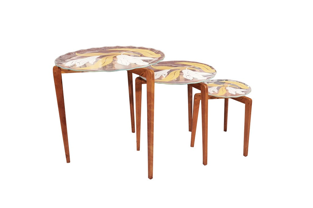 Set of three glass top nesting tables attributed to for Glass top nesting tables