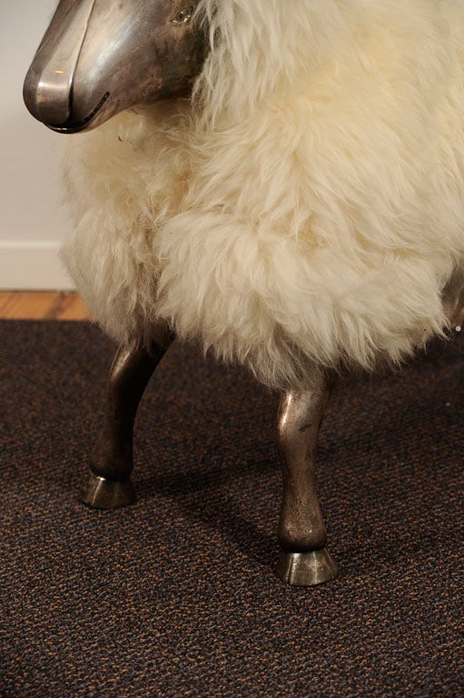 Pair of sheep benches/sculptures designed after Francois Xavier Lalanne, French sculptor of surrealistic animals that doubled as furniture, circa 1960's-70's.<br />