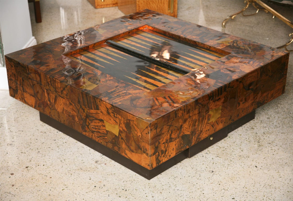 The Copper And Brass Patchwork Clad Frame With An Inset Backgammon Table On Ebonised Base