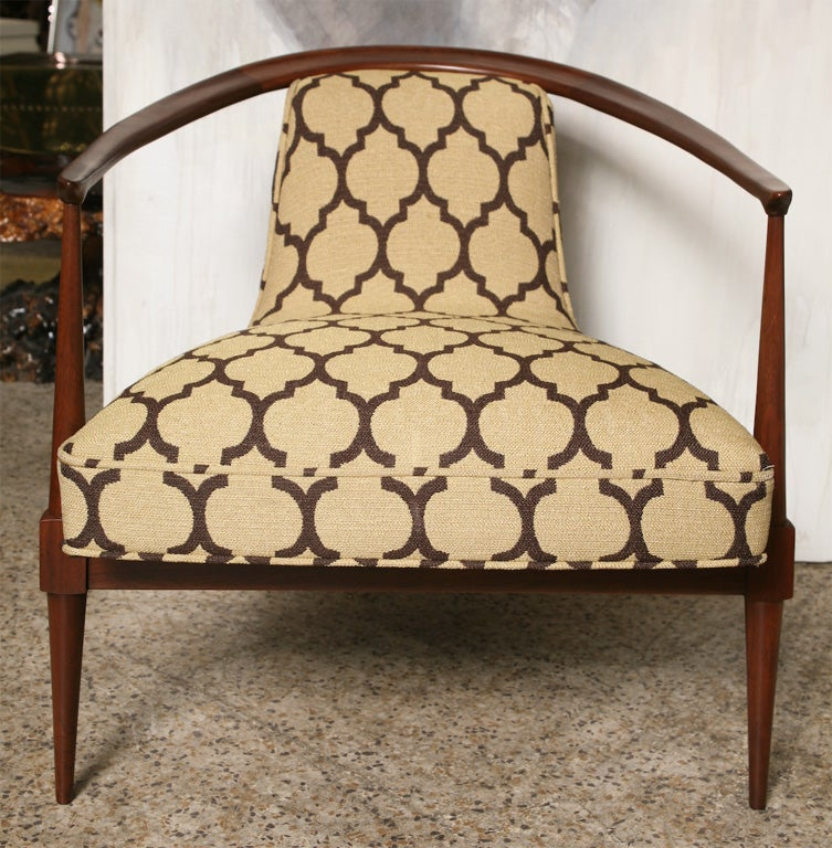 These curvy, sexy, low-slung, 60's walnut chairs have both masculine/feminine and Occidental/Oriental characteristics. Whatever ...we love the mix!