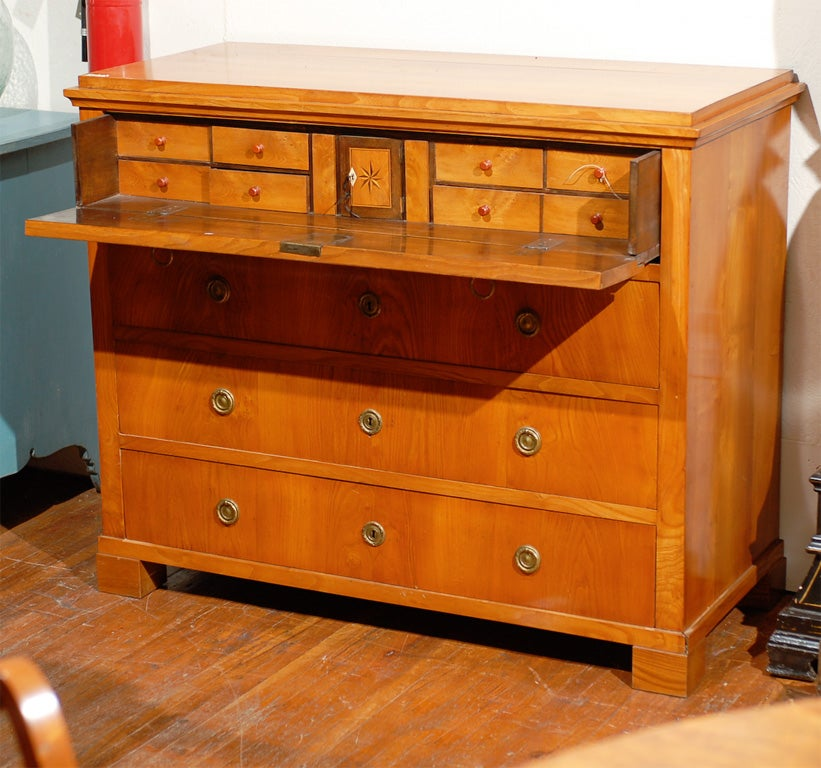 A Swedish period Karl Johan butler's desk or chest with pull-out desk over three drawers. The desk consists of eight drawers, a small center cabinet with an inlay star flanked by two hidden vertical compartments.  The Karl Johan period follows the