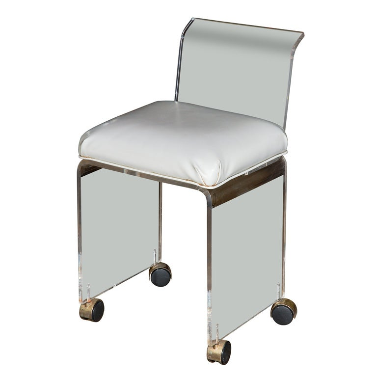 Lucite vanity chair with casters