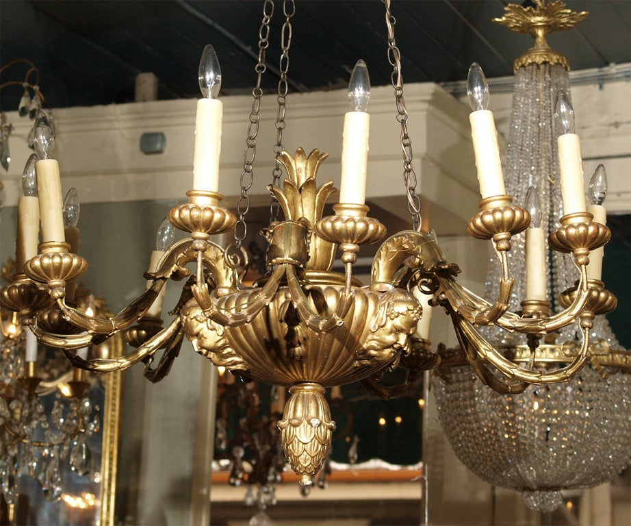 Antique Italian carved giltwood twelve light chandelier. 3