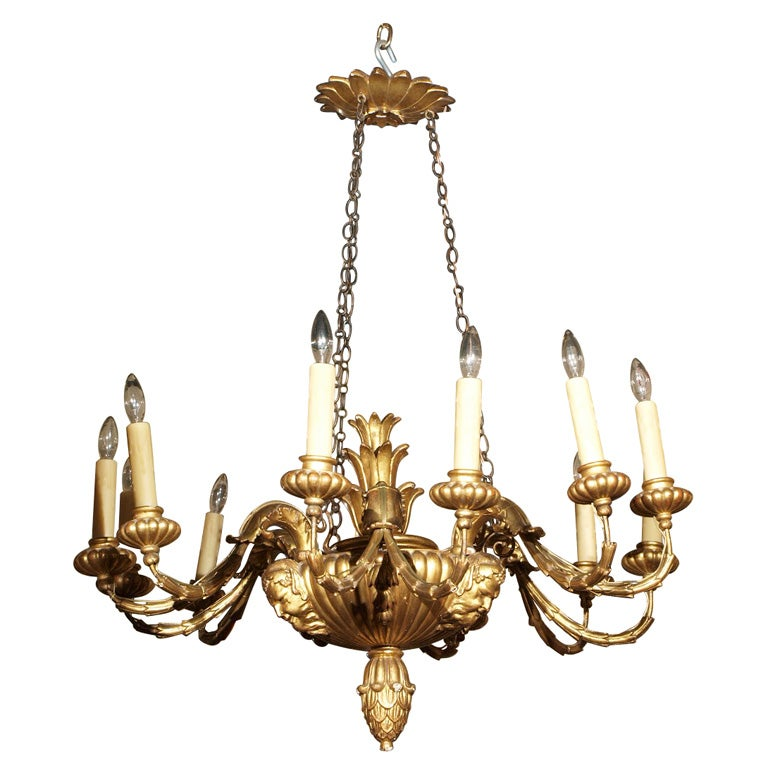 Antique Italian carved giltwood twelve light chandelier. 1