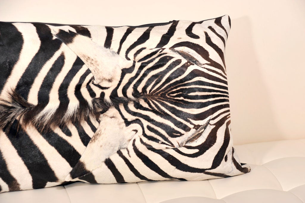 Beautiful zebra pillows.  Backed with beautiful brown Italian lambskin leather.  Price is $450 for 16 inches x 16 inches. We no longer have the larger size zebra pillow.