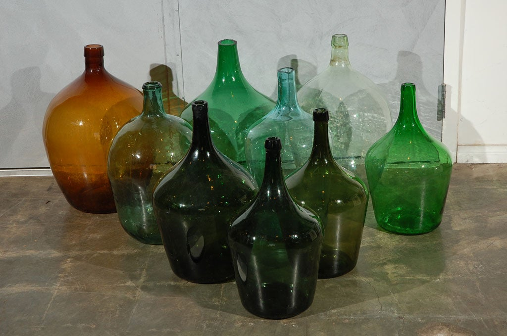 One of these large early 20th century glass bottles (mostly in a shade of green) may make an interesting element in one of your settings. They are priced (at $295.00 each or less) and sold individually, so take as many as you like.<br />