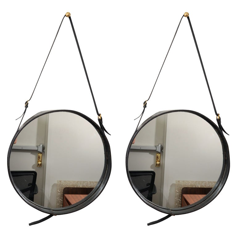 Pair of large Jacques Adnet mirrors
