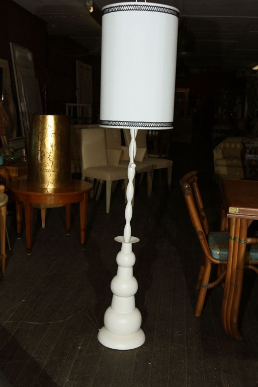 Shapely white painted metal floor lamp with cylindrical shade. Measures: Shade is 21