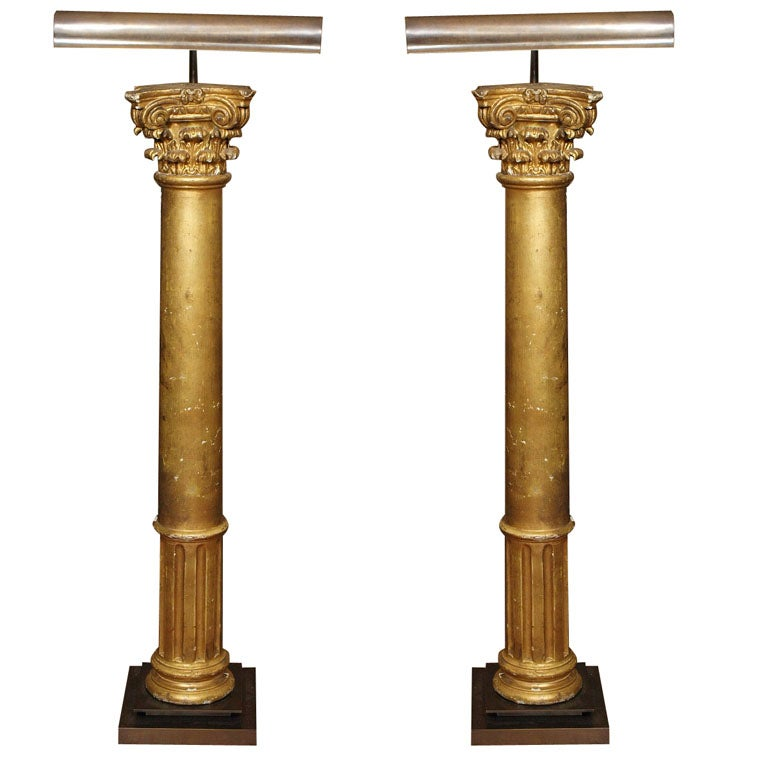 Pair of Late 19th Century Gilded Columns Made into Lamps Set on Steel Bases For Sale