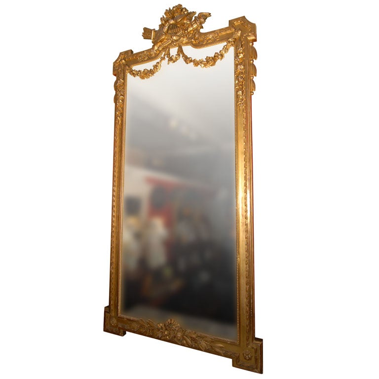 A handsome large French hall (portrait or pier) mirror featuring a carved giltwood frame.
