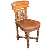 French Gambler's Chair of Carved Oak and Leather