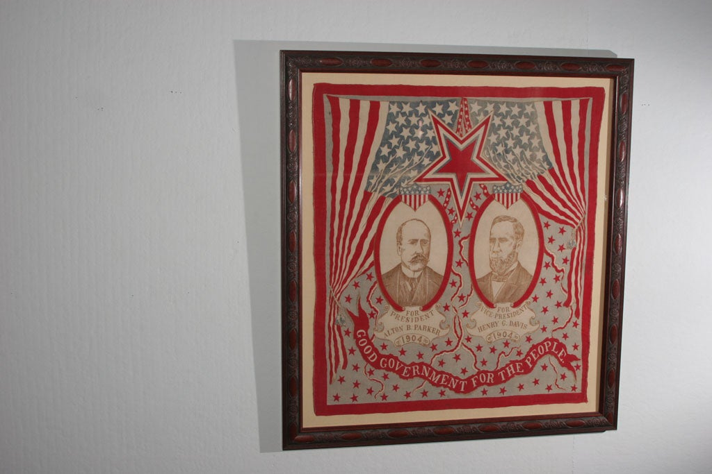 """Theatrical flag curtains open on a star spangled presentation of candidates, """"For president/ Alton B. Parker/1904/ For Vice President/ Henry G. Davis/ 1904"""" with a banner promoting """"Good government for the people"""".  Portrait of"""