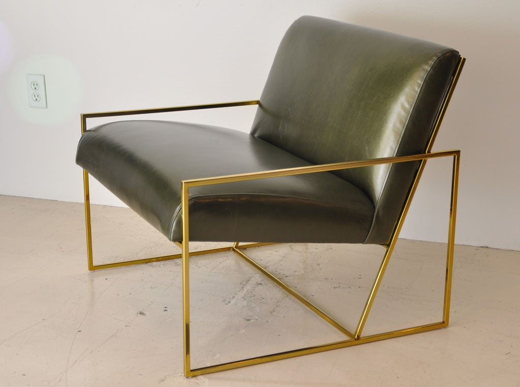 Pair of new thin-frame brass chairs in green leather.  Can be sold individually.  Also available to order COM/COL.