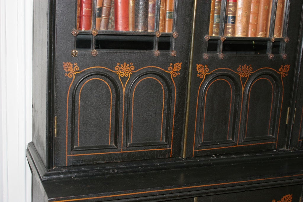 AN UNUSUAL REGENCY EBONIZED FOUR DOOR BOOKCASE image 4