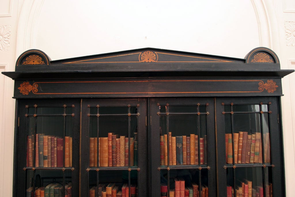 AN UNUSUAL REGENCY EBONIZED FOUR DOOR BOOKCASE image 7