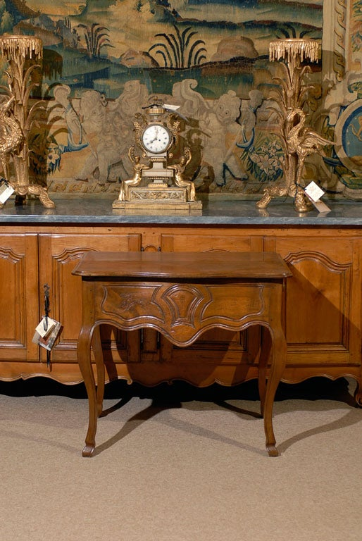 A Louis XV Walnut Console Table with Carved Frieze, Hoof Feet and Side Drawer - dating from the mid 18th century and French in origin.  For many more fine antiques, please visit our online galleries at William Word Fine Antiques: Atlanta's source