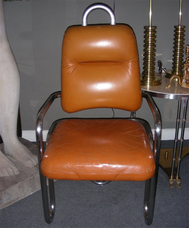 Two 1971 armchairs by Kwok Hoi Chan for Steiner with structure in chromed metal. Back-rest and seating in tan leather.