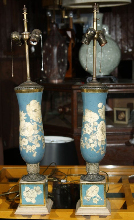 A pair of blue and off, white floral églomisé columnar lamps. Lamp body without rod is 20