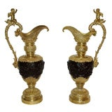 Clodion, Pair of ewers in bronze with two patinas, late 19th century