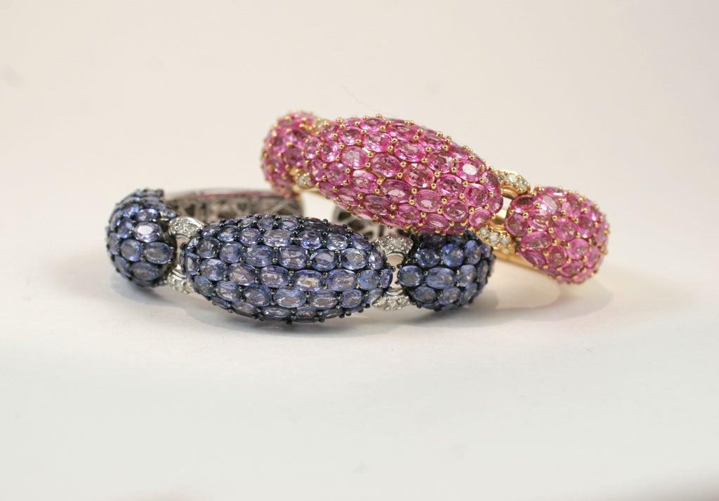 18 K Pink and Blue Sapphire Wide Diamond Cuff Bracelets <br /> <br /> Blue sapphire 55.00 Diamonds .54 $16,000<br /> Pink Sapphire 43.72 Diamonds .54 $16,500
