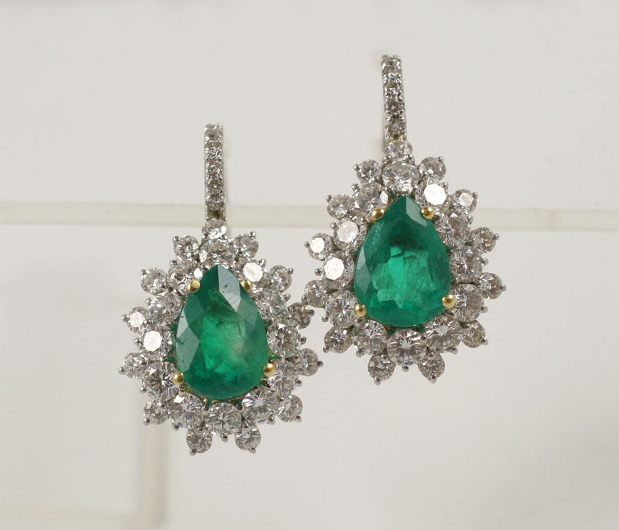 Exquisite Emerald and Diamond Earrings 5.23 Total weight in Diamonds 7.23 in Emeralds suspended by a diamond wire