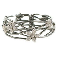 18 K Black Gold  Bangle with Diamond Flower Motif