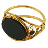Goldtone Cuff Bracelet with Large Black Stone