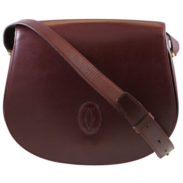 cartier burgundy shoulder bag at 1stdibs
