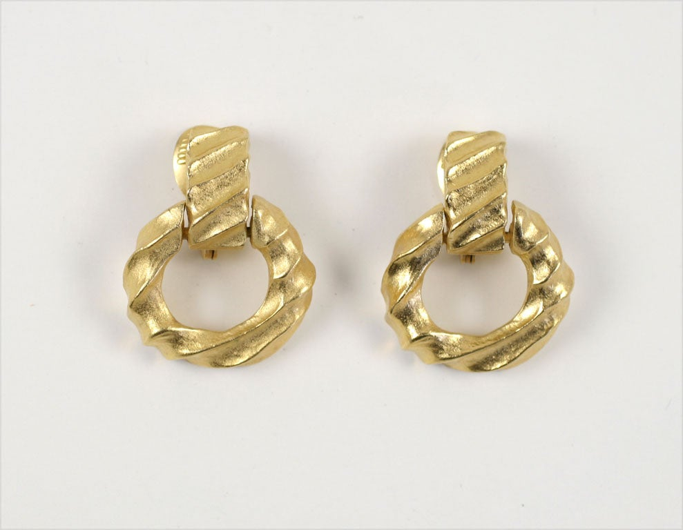 Soft goldtone finish, diagonal raised pattern hoop earrings.