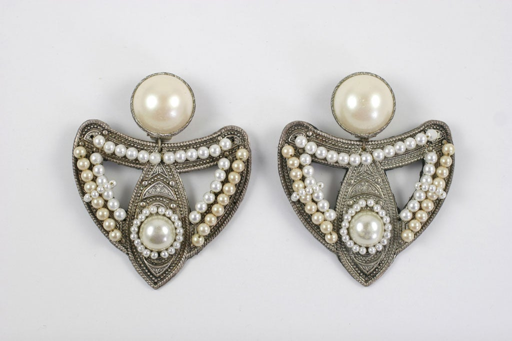 Large exotic silver and faux pearl earrings.
