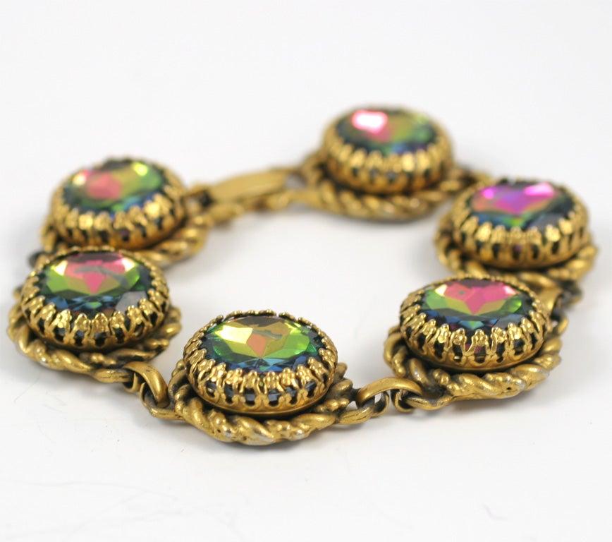 Six round, faceted, prong set, watermelon stones in the goldtone link bracelet designed by the legendary Elsa Schiaparelli.