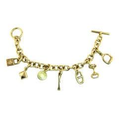 HERMES 18K Gold 7-Charm Toggle Link Bracelet