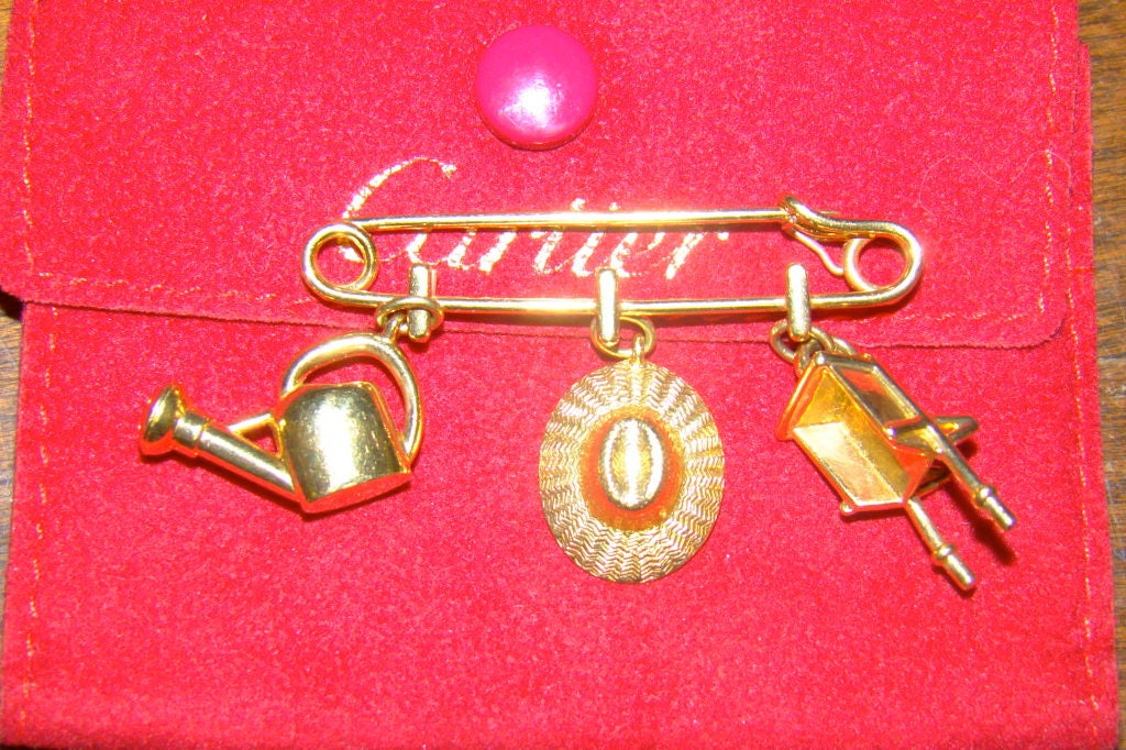 a32d1ab03e353 Cartier 18K Yellow Gold Safety Pin w/ Gardening Charms