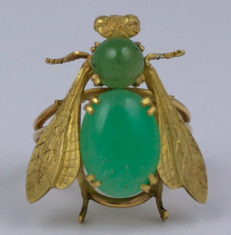 Oversized statement ring from the 1970s in 18K and crysophrase. Impressively scaled with large cabochon oval crysophrase (16mm x 12mm)set in the body. A smaller jade cab. forms the upper body. The gold is finely etched and detailed in the wings,