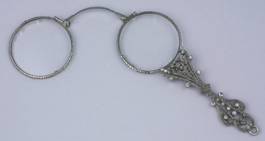 Edwardian pave rose diamond lorgnette completely covered in stones and set in platinum.