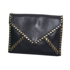 Yves St. Laurent blue + gold leather envelope clutch