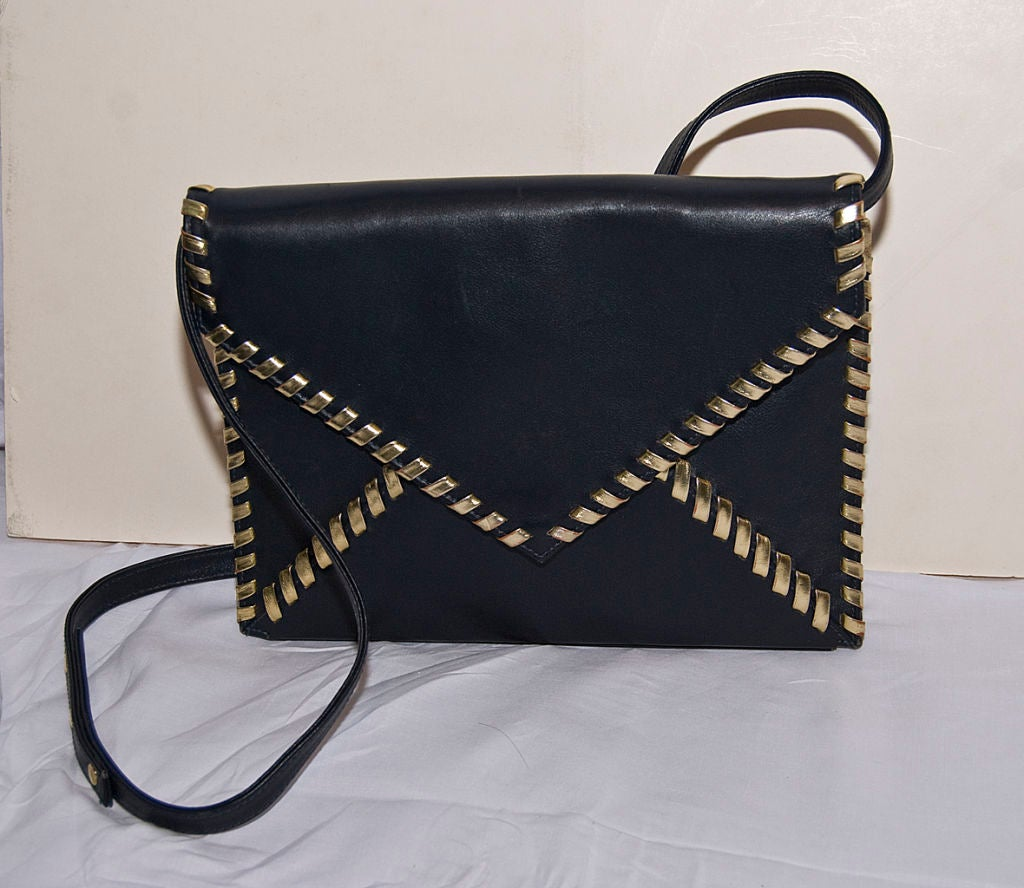 Women's Yves St. Laurent blue + gold leather envelope clutch