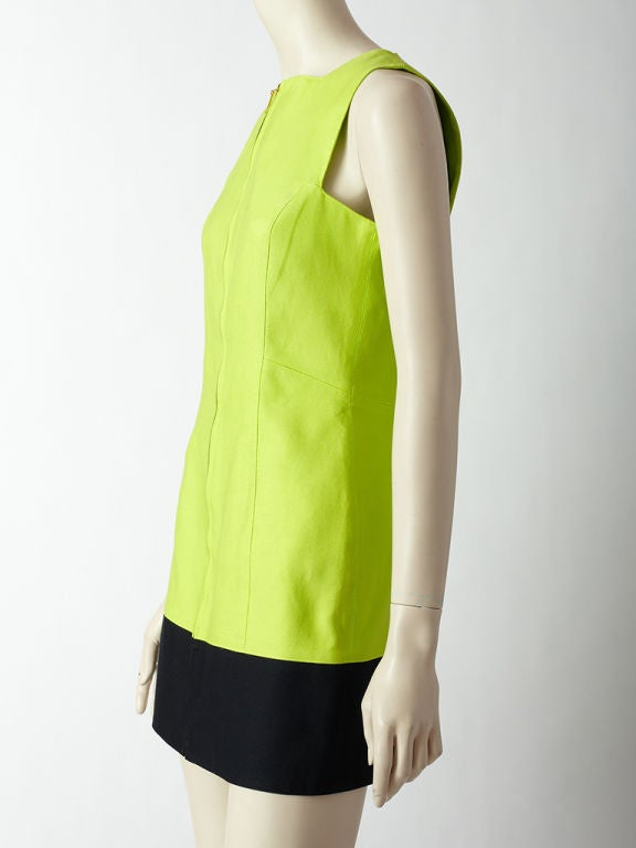 Claude Montana acid green and black color block, fitted, sleeveless dress with front zipper and square neckline.