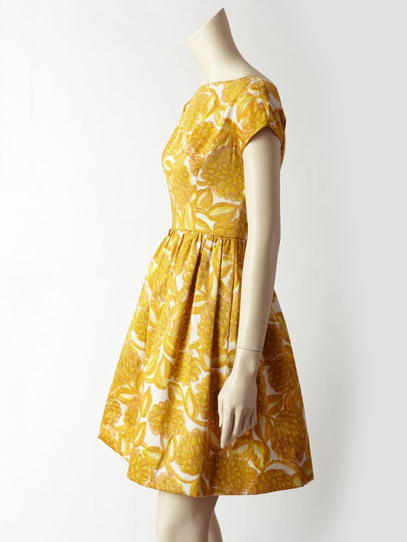 Elizabeth Arden mustard and white, large floral printed, cotton sateen, cap sleeve dress. Beautifully made with an organza lining, gathered waist, boat neckline and open back details.