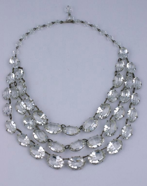 """Unusually large bib necklace composed of 3 strands of claw set sparkling, oval glass pastes, attached to an adjustable crystal beaded back chain. 1930's USA. Excellent condition.  16"""" length,  Each Stone .75"""" x .50"""", Drape 2.5"""""""